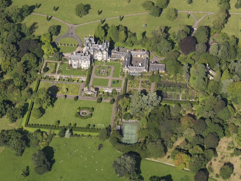 Oblique aerial view centred on the house with the gardens adjacent, taken from the SSE.