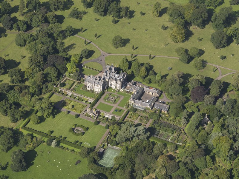 Oblique aerial view centred on the house with the gardens adjacent, taken from the SE.