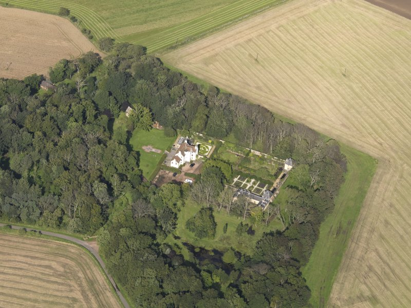 Oblique aerial view centred on the House with the gardens adjacent , taken from the SSE.