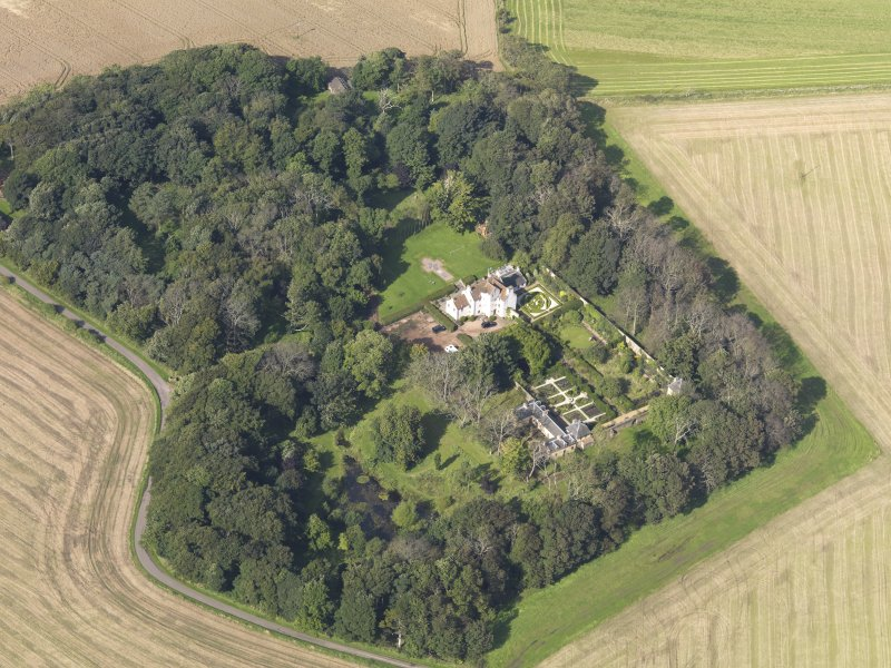 Oblique aerial view centred on the House with the gardens adjacent , taken from the SE.