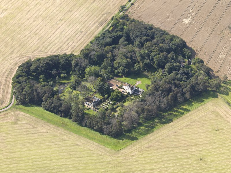 General oblique aerial view centred on the House with the gardens adjacent , taken from the NE.