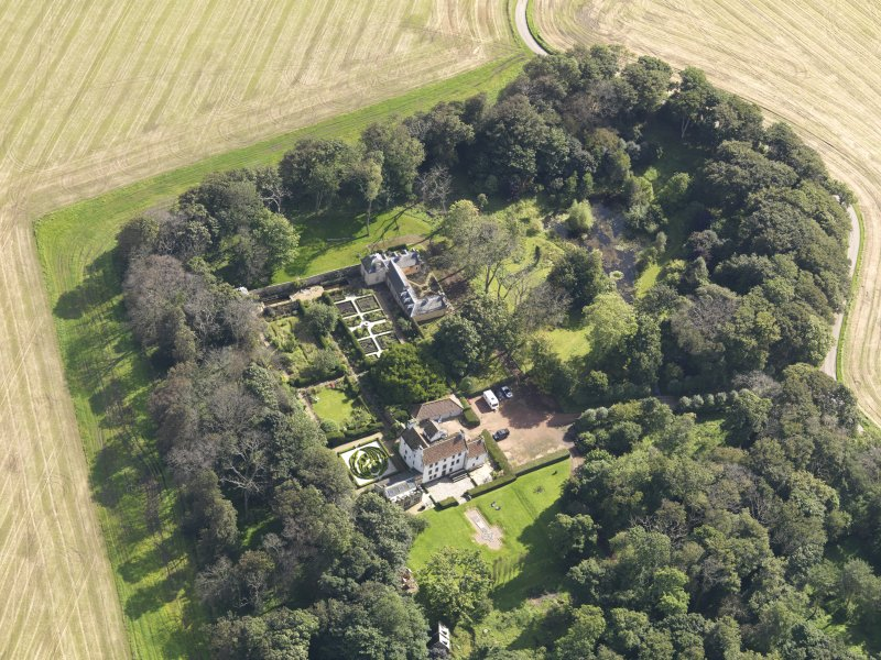 Oblique aerial view centred on the House with the gardens adjacent , taken from the SW.