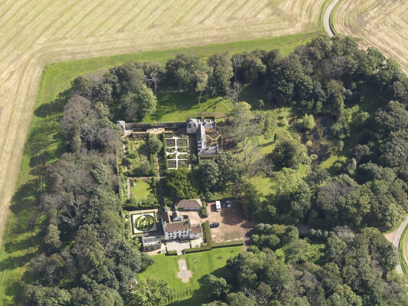 Oblique aerial view centred on the House with the gardens adjacent , taken from the W.