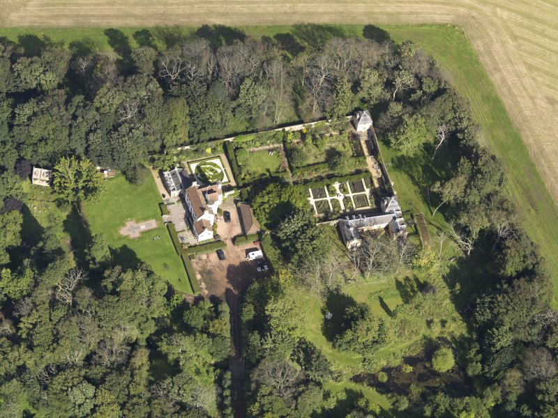 Oblique aerial view centred on the House with the gardens adjacent , taken from the S.
