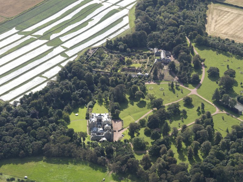 General oblique aerial view centred on the country house with the gardens adjacent , taken from the NNW.