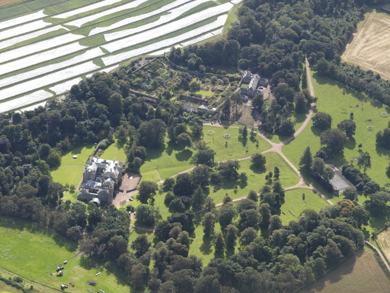 General oblique aerial view centred on the country house with the gardens adjacent , taken from the  N.
