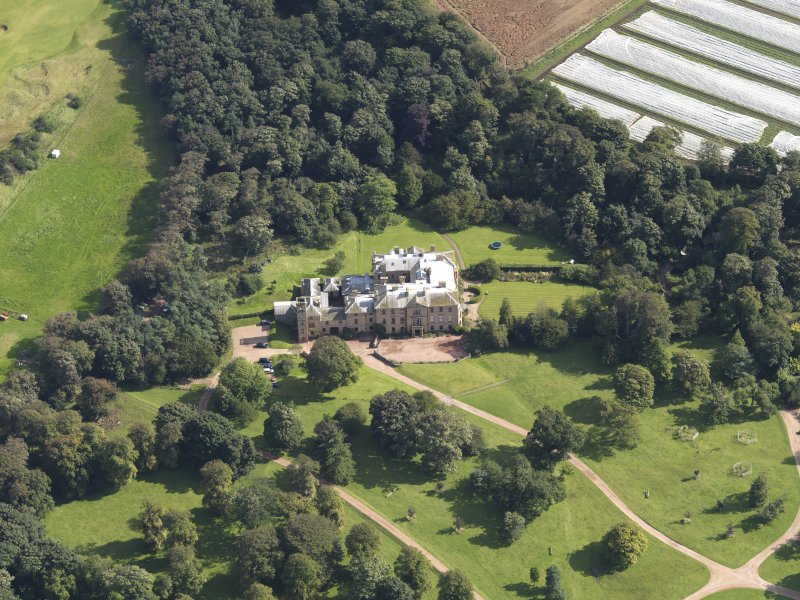 Oblique aerial view centred on the country house , taken from the WSW.