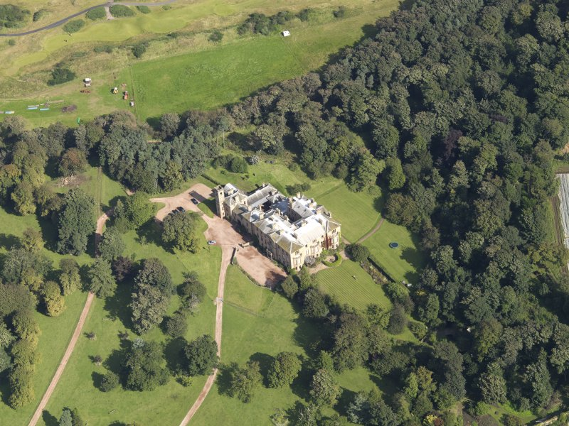 Oblique aerial view centred on the country house , taken from the SW.