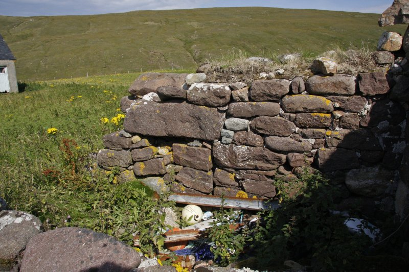 Kearvaig Farmsteading. View from the W of the blocked fireplace in the inner face of the E gable of the range.