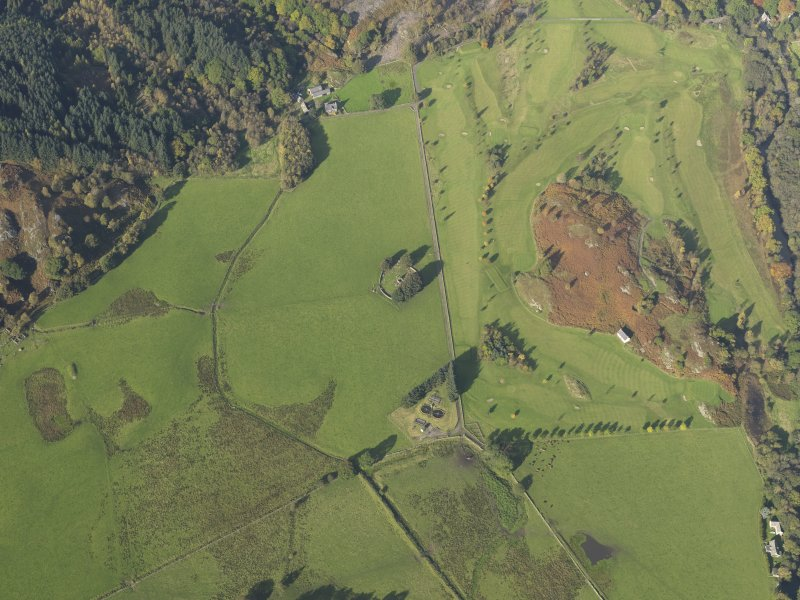 Oblique aerial view centred on the remains of St Fillans chapel, taken from the ESE.
