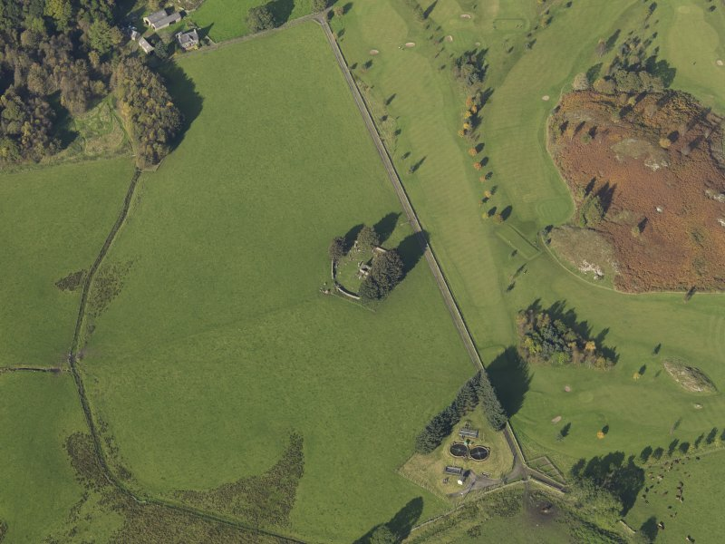 Oblique aerial view centred on the remains of St Fillans chapel, taken from the SE.