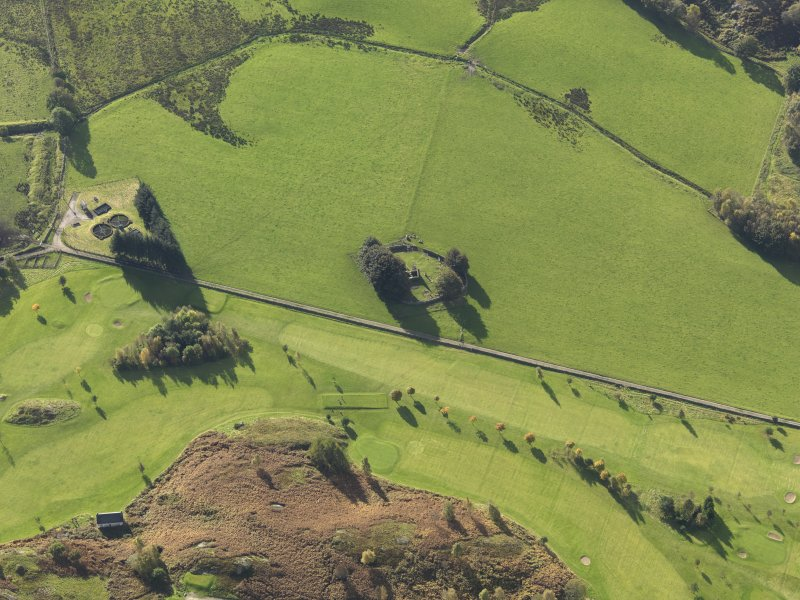 Oblique aerial view centred on the remains of St Fillans chapel, taken from the NE.