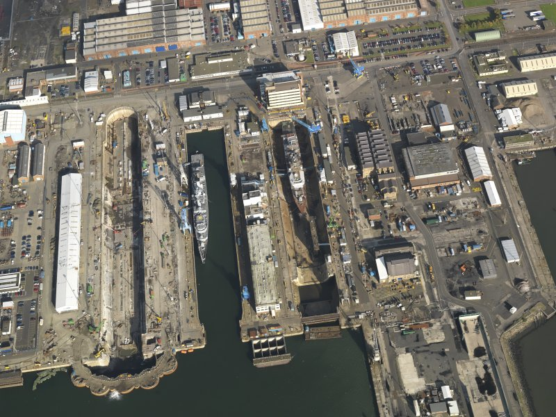 Oblique aerial view centred on the dry docks, taken from the S.
