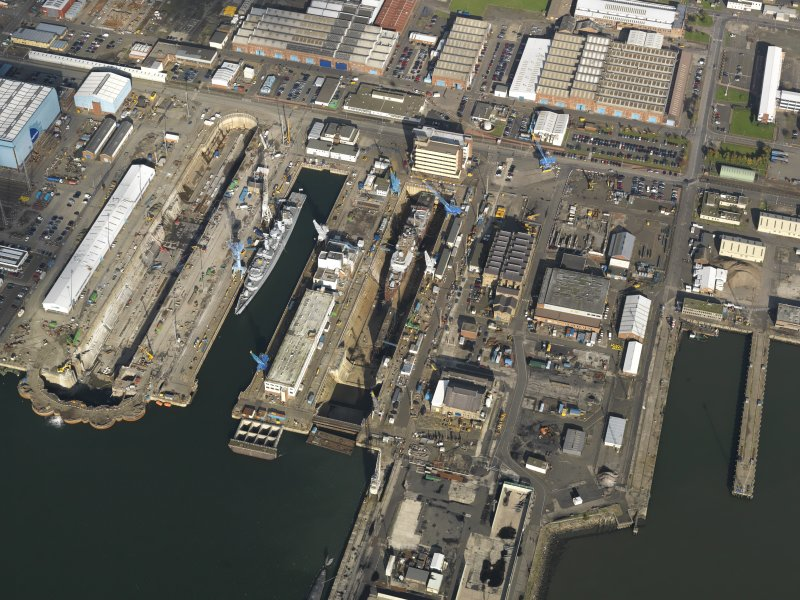 Oblique aerial view centred on the dry docks, taken from the SSE.