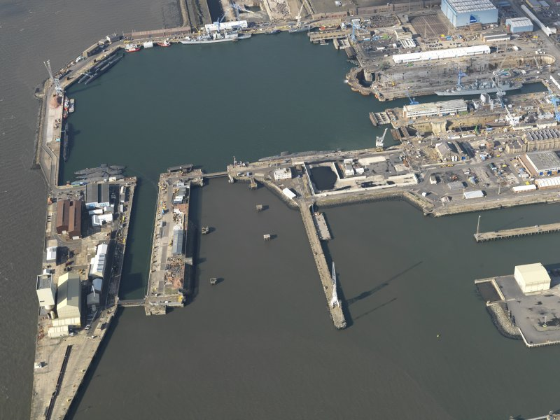 Oblique aerial view centred on the dockyard, taken from the  ESE.