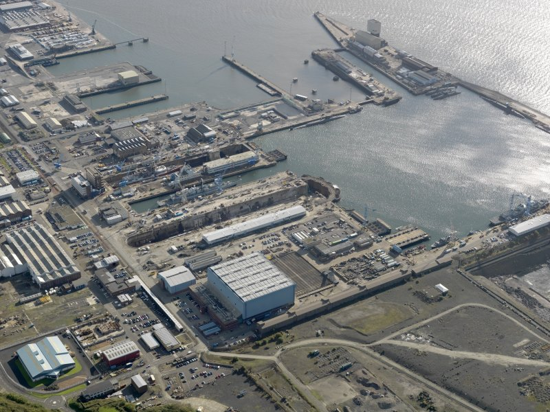 Oblique aerial view centred on the dockyard, taken from the WNW.