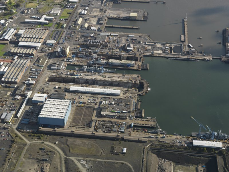 Oblique aerial view centred on the dry docks, taken from the W.