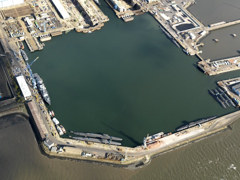 Oblique aerial view centred on the main basin of Rosyth Dockyard, taken from the SW.