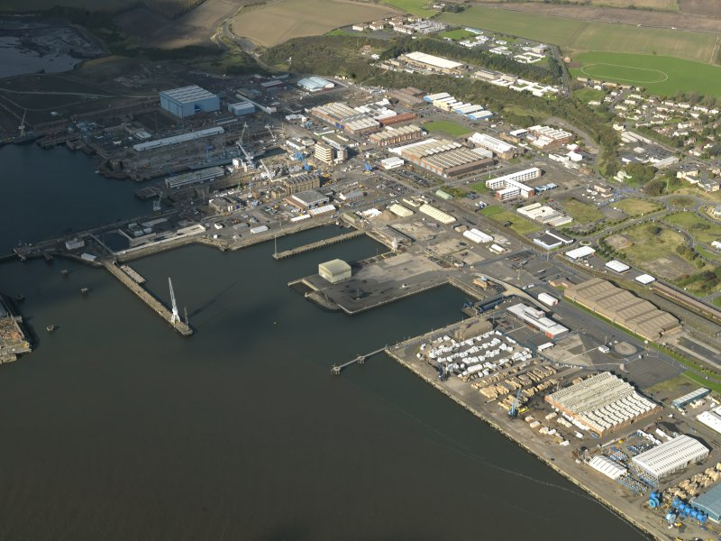 General oblique aerial view centred on the dockyard, taken from the SE.