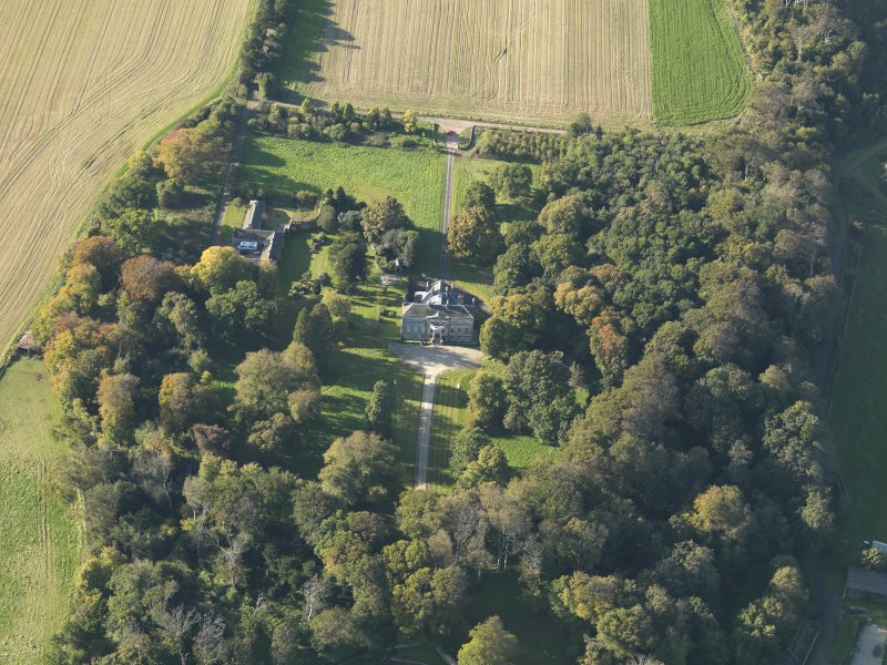 Oblique aerial view centred on the house, taken from the ESE.
