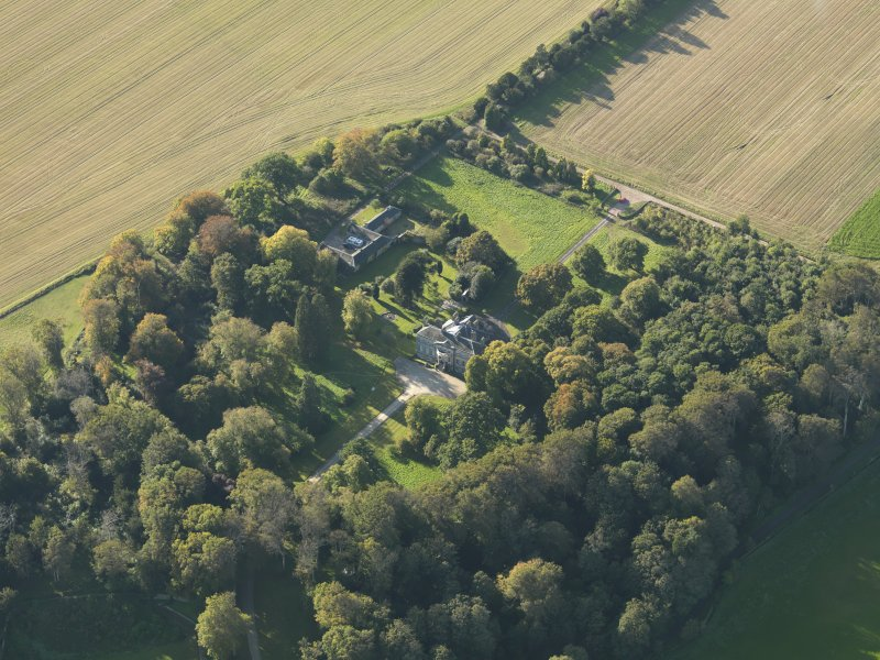 Oblique aerial view centred on the house, taken from the E.