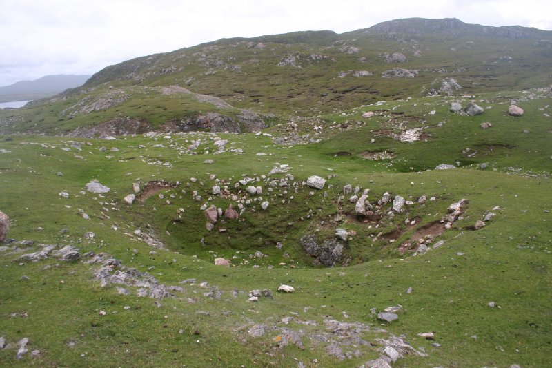A large bomb crater situated within the E end of the fort (NC37SE 1) on Eilean nan Caorach.