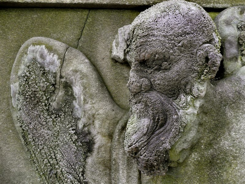 Detail of sculpture on monument located near to the entrance of Calton Old Burial Ground.