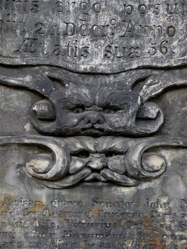 Detail of sculpture on monument in memory of John Milne (died 1667), Royal Master Mason.  Located by Eastern entrance to Greyfriars Cemetery.