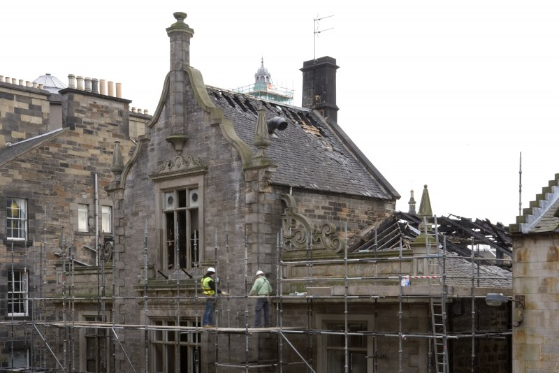 Detail of central gable and fire damaged roof on north elevation of former St John's Church, taken from NW on Victoria Terrace