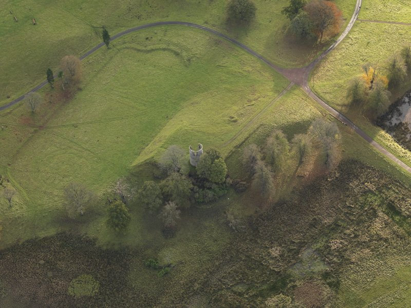 Oblique aerial view centred on the remains of the castle and gardens , taken from the N.