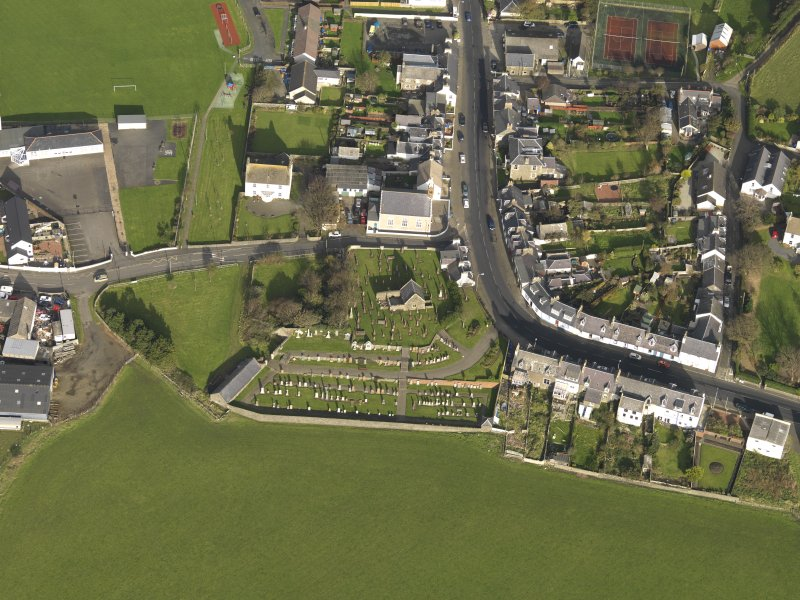 Oblique aerial view centred on the church (s) with the graveyard adjacent, taken from the S.