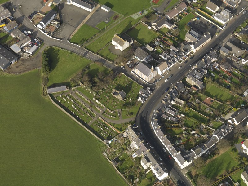Oblique aerial view centred on the church (s) with the graveyard adjacent, taken from the SE.