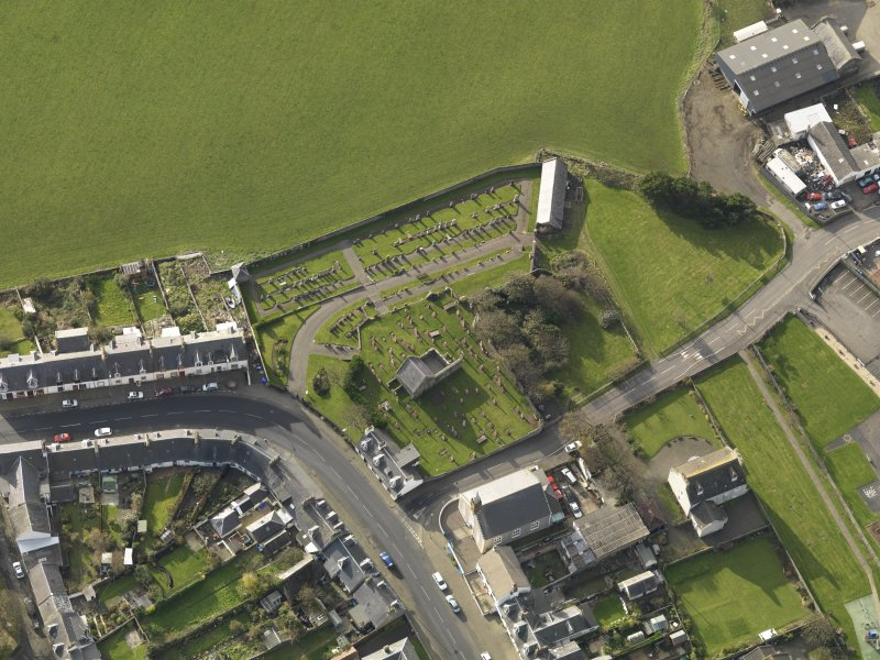 Oblique aerial view centred on the church (s) with the graveyard adjacent, taken from the NE.