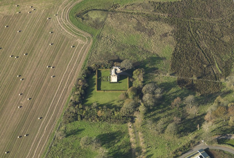 Oblique aerial view centred on the tower house, taken from the NE.