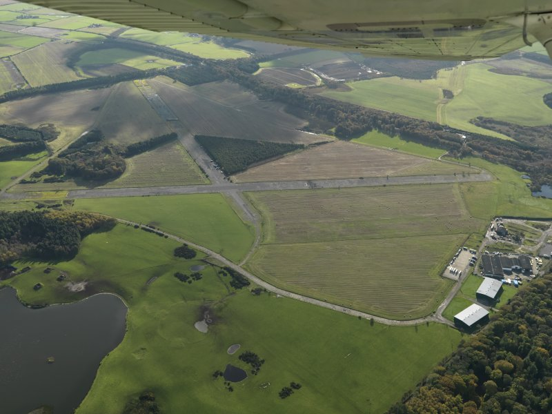 General oblique aerial view centred on the airfield, taken from the NNW.