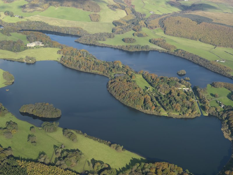 General oblique aerial view centred on the ruins and gardens of Castle Kennedy and Lochinch Castle, taken from the SW.
