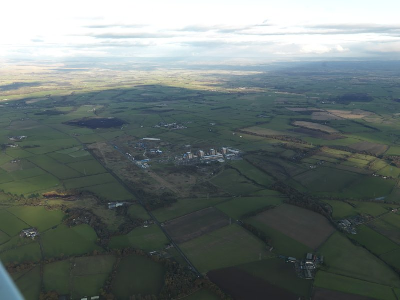 General oblique aerial view centred on the airfield with the Nuclear Power Station adjacent, taken from the SW.