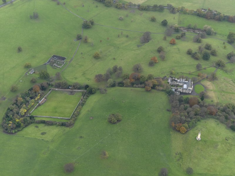 Oblique aerial view centred on the walled garden with the remains of a farmstead adjacent, taken from the ENE.
