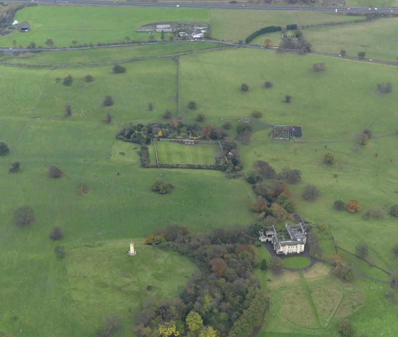 Oblique aerial view centred on the country house with the walled garden adjacent, taken from the N.