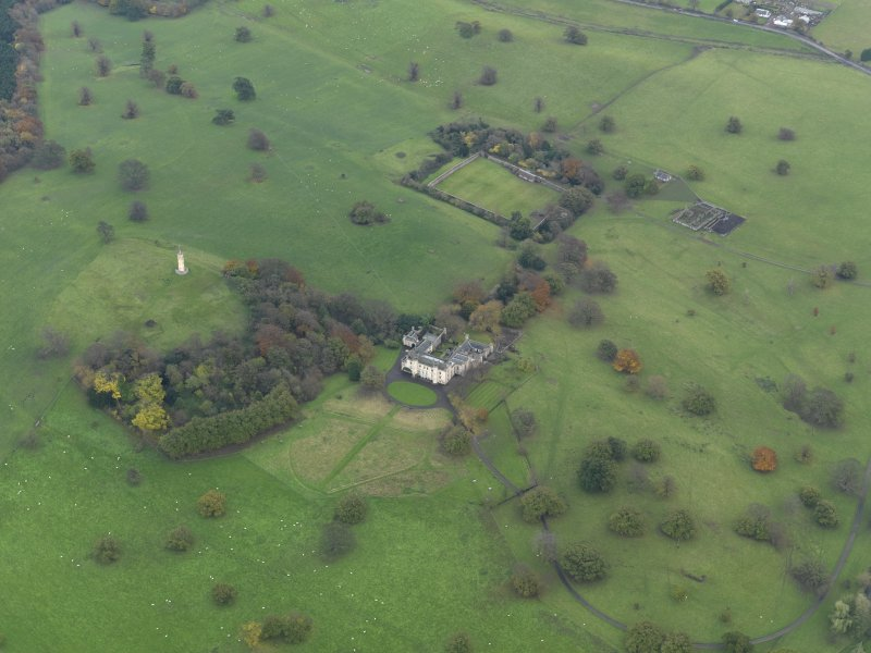 Oblique aerial view centred on the country house with the walled garden adjacent, taken from the NW.