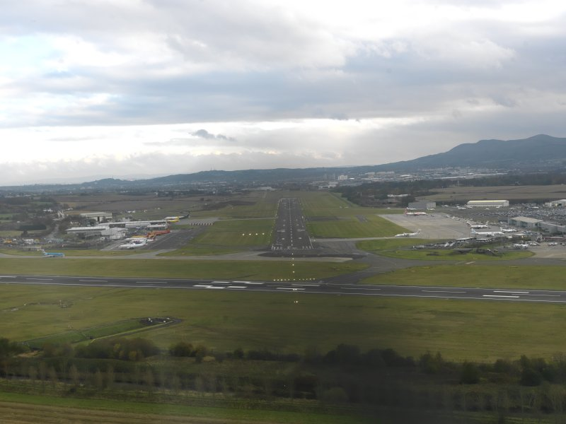 Oblique aerial view centred on the SE-NW runway, taken from the NW.