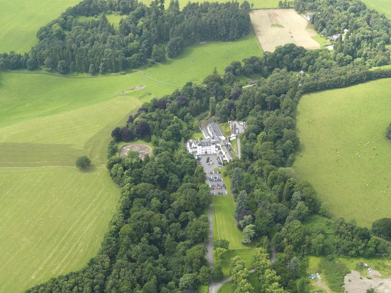 General oblique aerial view centred on the hotel with the stables adjacent, taken from the ENE.