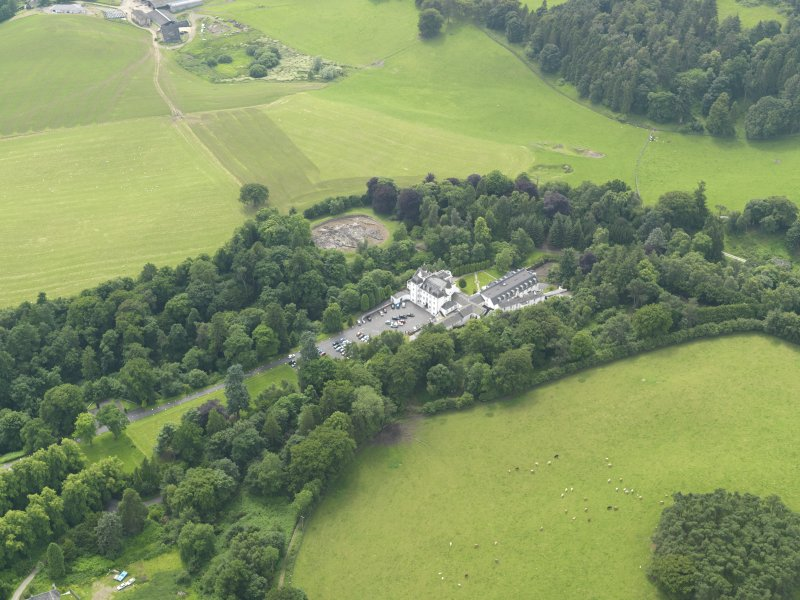 General oblique aerial view centred on the hotel with the stables adjacent, taken from the NE.