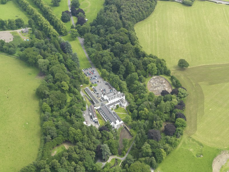 General oblique aerial view centred on the hotel with the stables adjacent, taken from the NW.