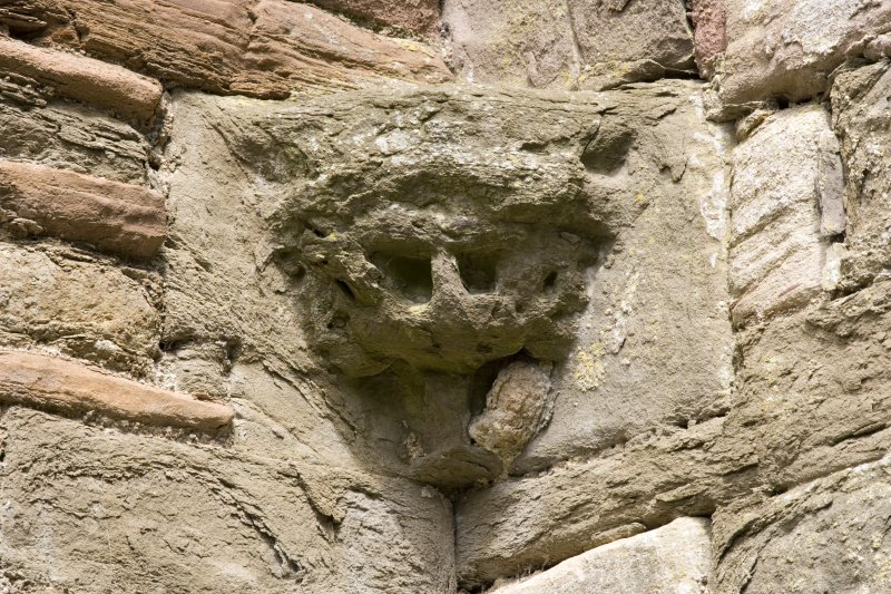 E end of chapter-house, detail of corbel in NE corner