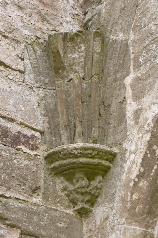 E end of chapter-house, detail of corbel and springers of vault ribs in SW corner