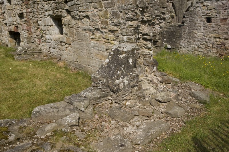 N transept, view of walling at NE corner from SE