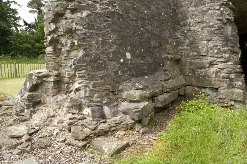 N transept, view of walling at NE corner from NE showing drip course