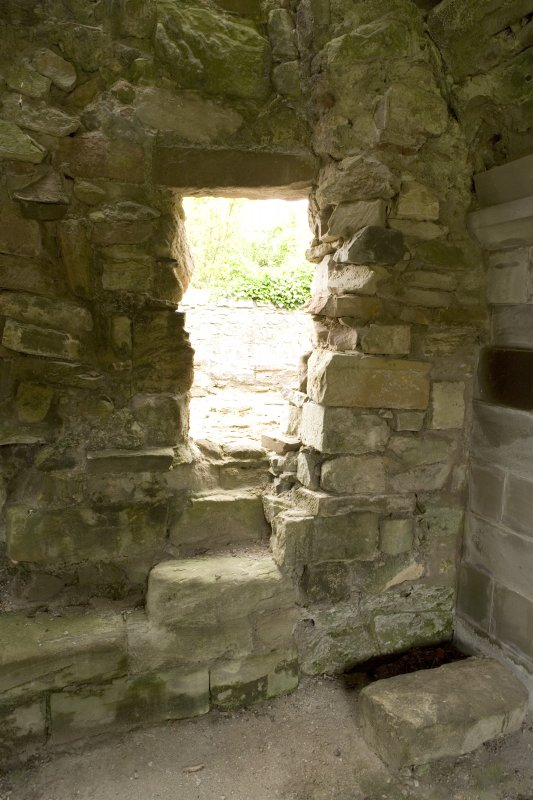 Interior. Sacristy/bakehouse, view of opening in W wall leading to bread oven