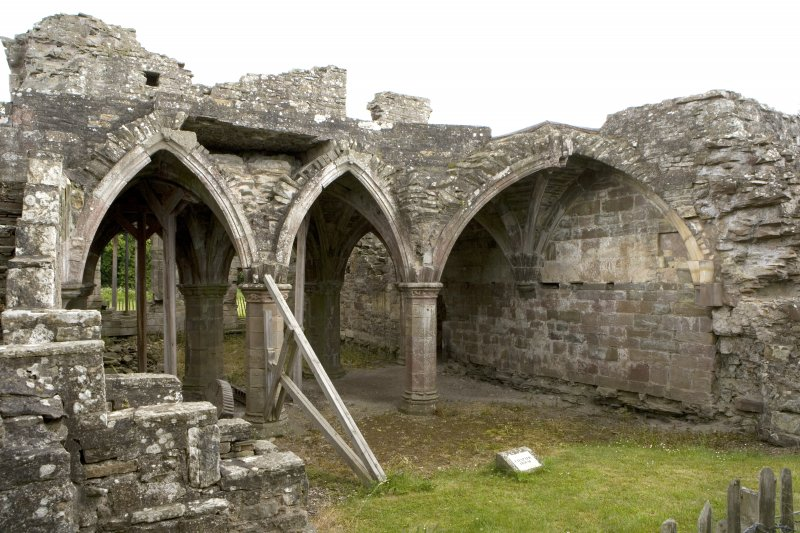 Chapter-house, W end, view of arcading and vaulting from NW